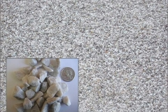 "½"" size crushed white decorative stone."